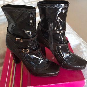 BCBG dark brown patent boots.